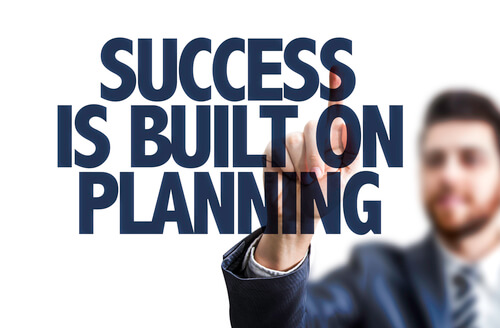 A man writing success is built on planning
