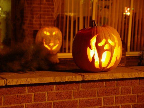 Two pumpkins outside a house
