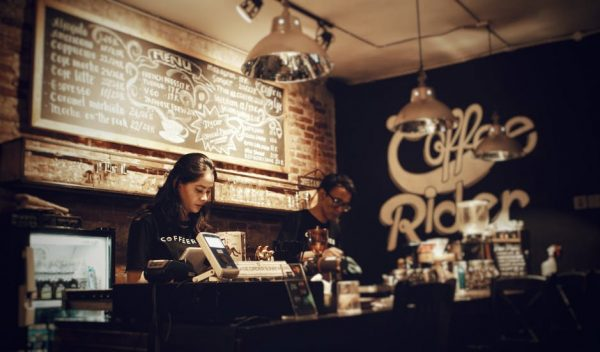 People behind the counter in a coffee shop