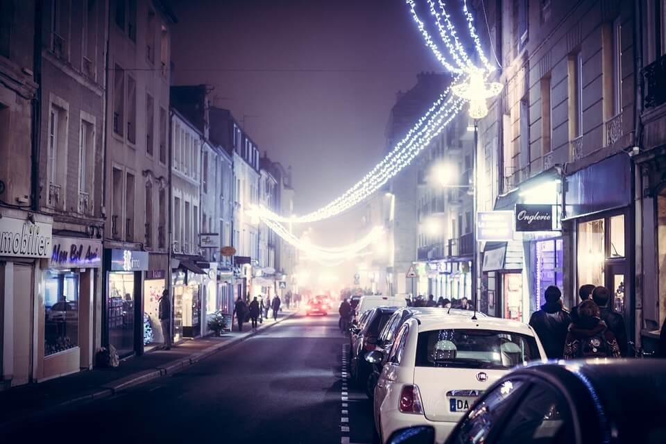 dark highstreet with christmas lights