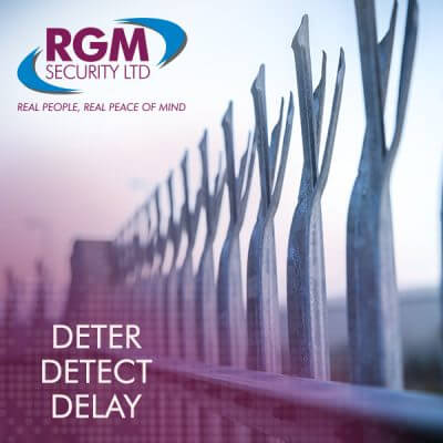 A fence with deter detect delay written on it