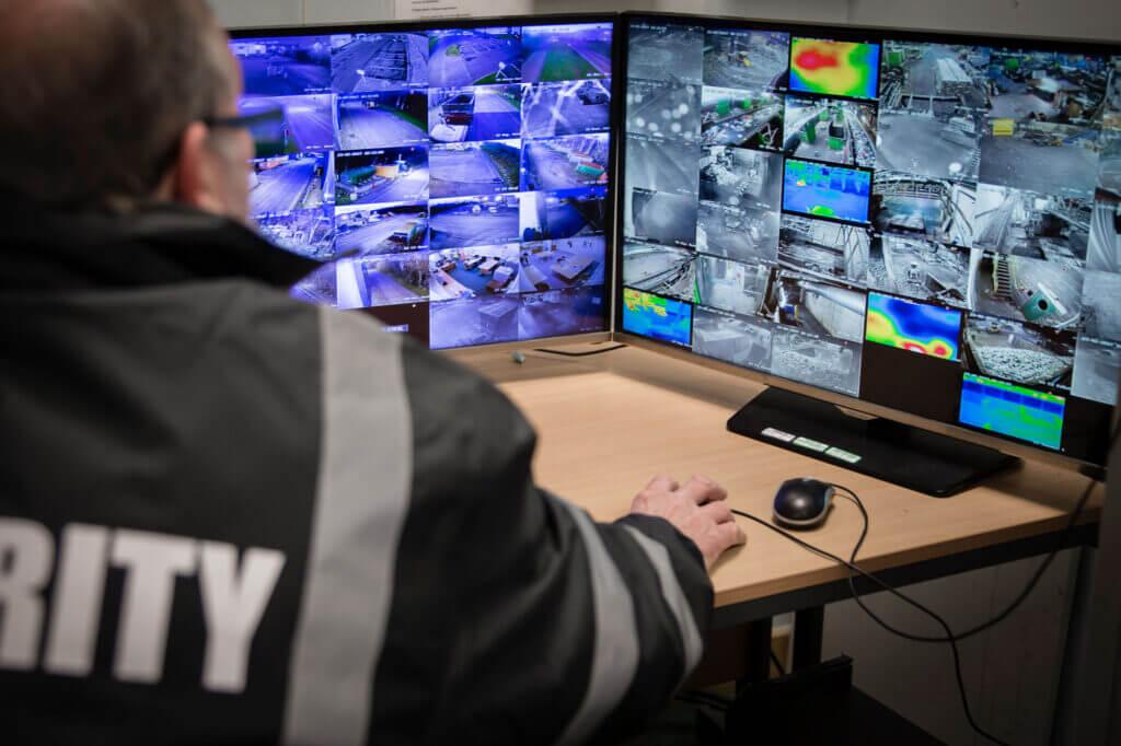 security officer monitoring cctv cameras