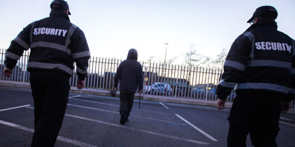 security guards escorting a criminal offsite