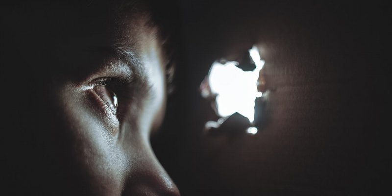 a child looking through a peephole