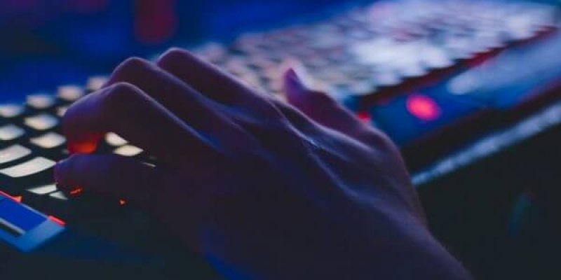 close up of a hand on a computer keyboard